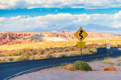 Winding road with signs in Valley of Fire State Park, Nevada Stock Photography