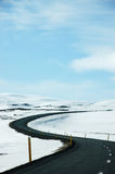 Winding road, snow, blue sky, Dettifoss, Iceland Stock Photography