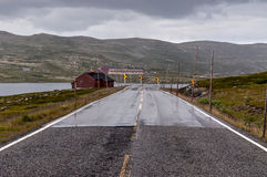 Winding road with snow levels in Norway Stock Photography