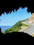 Winding road at a steep coast Stock Image