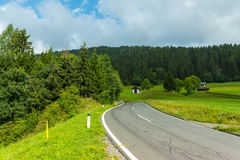 Winding Road Through Summer Countryside. Horizontal shot Royalty Free Stock Images