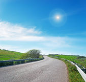 Winding road with sun Stock Photos