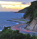 Winding road on sunset Stock Photography