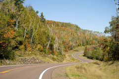 Winding Road Through Autumn Forest Stock Photography