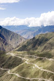 Winding road in Tibet. Winding road lies in mountain in Tibet Royalty Free Stock Photos
