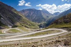 Winding road in Tien Shan mountains Stock Photo