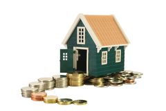 Winding road to homeownership. Ascending and winding money road leading to a house - isolated (clipping path