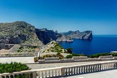 Winding road to lighthouse of Cap de Formentor and rocky coast of Mediterranean sea, Mallorca Stock Photo