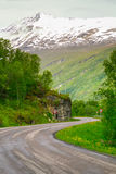 The winding road to the mountain Stock Image