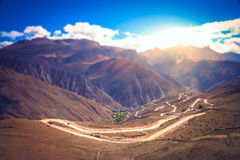 Winding road to mountain pass Royalty Free Stock Images