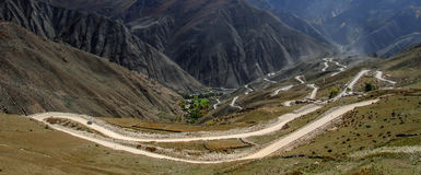 Winding road to mountain pass Royalty Free Stock Image