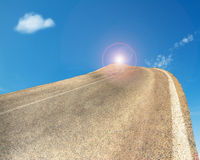 Winding road to the sun Stock Photography