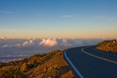 A winding road to the Top of the World. A breahtaking view of the sky at sunrise on the road to the top of the Haleakala Vocano. Maui, Hawaii stock image