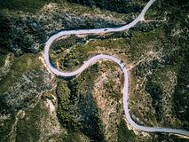 Winding road aerial view. Winding road top aerial view drone shot, Sithonia, Greece stock photo