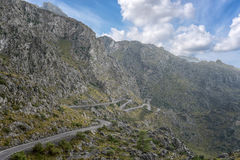 Winding road through the Tramuntana mountains of Mallorca. With a blue sky in the background. It is the way to Cala Tuent Royalty Free Stock Images