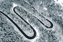 Winding road trough a mountain pass in the winter season snowy road stock photography