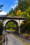 Winding Road under Bridge. A backroad in the Pacific Northwest in early Autumn Royalty Free Stock Photography