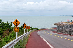 Winding Road with Warning Traffic Signs Royalty Free Stock Image