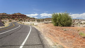 Winding road wih cars through empty wilderness stock footage
