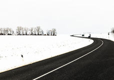 Winding road in winter landscape in Thuringia Royalty Free Stock Photos