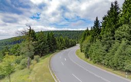 Winding road  the wooded hills Stock Photography