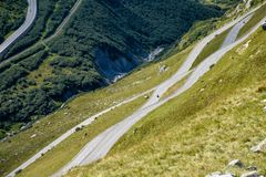 Winding roads looking like waves in the Swiss Alps. In dark and light green hues royalty free stock photos