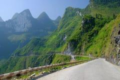 Winding roads through valleys and karst mountain scenery in the North Vietnamese region of Ha Giang / Van