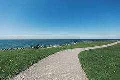 Winding Seaside Path with Bicyclist Royalty Free Stock Photography