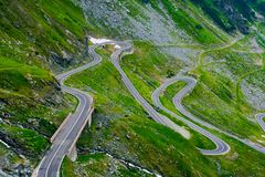 Winding serpentine of the TransFagarasan road. Beautiful transportation background. popular tourist destination in Romania royalty free stock photo