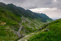Winding serpentine of the TransFagarasan road. Beautiful transportation background. popular tourist destination in Romania royalty free stock photos