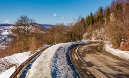 Winding serpentine in winter mountains. Winding serpentine in winter. lovely transportation scenery in mountains Stock Photo