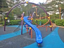 Winding slide in playground Stock Photos
