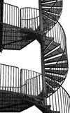 Winding spiral staircase, black and white image. Stock Photo