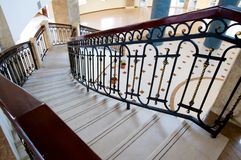 Winding staircase with forged rail. Interior stone winding staircase with forged rail stock photos