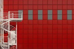 Winding stairs on a red background Royalty Free Stock Images