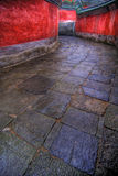 Winding stone path. Long winding stone path, flanked by two vivid red walls. Taken at the Wudang Shan temple in Hubei, China royalty free stock photos