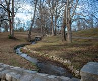 Winding Stream with a stone bridge in foreground stock photos