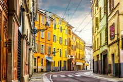 Winding street with colorful houses in Parma Royalty Free Stock Photography