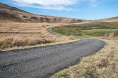 Winding tar roa in dry grasslands. Winding open tar roads in the dry grasslands in African farmlands Stock Images