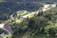 Winding uphill road with many bends Royalty Free Stock Photo