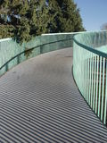 Winding Walkway. Curving Pedestrian Bridge Stock Photo