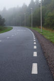 Winding walkway and cycle path on foggy morning Royalty Free Stock Photography
