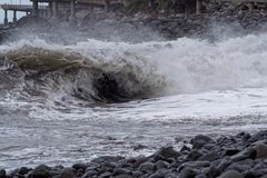 Winding wave on the coast at stormy weather. Portuguese island of Madeira stock images