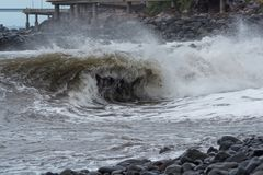 Winding wave on the coast at stormy weather. Portuguese island of Madeira royalty free stock images