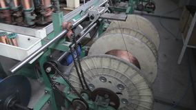 Winding of a wire on a bobbin. Winding of metal wire on a bobbin in production