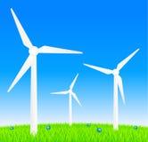 Windkraftanlagen auf Wiese Stockfotografie