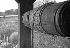 Windlass of the draw well. Old woodenmade windlass of the draw well in black and white Royalty Free Stock Photography