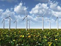 Windleistungturbinen auf einer Wiese. Stockfotos