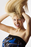 Windly blond hair Stock Photography