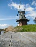 Windmühle durch die Landungstufe Stockfoto
